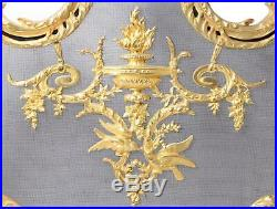 Antique French bronze fireplace set. France. Putti chenet, screen, tool set